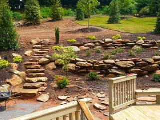Masonry Conctractor completed boulder retaining walls and boulder stairway to back of yard