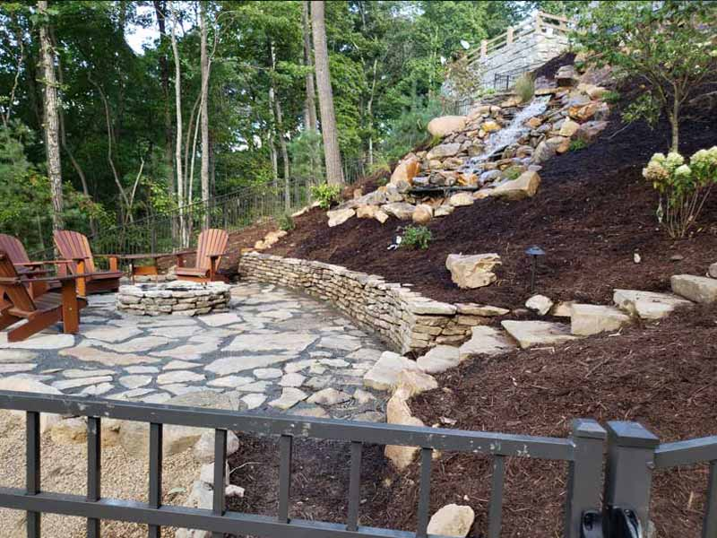 Stone Boulder Wall & Firepit Entertainment Areas