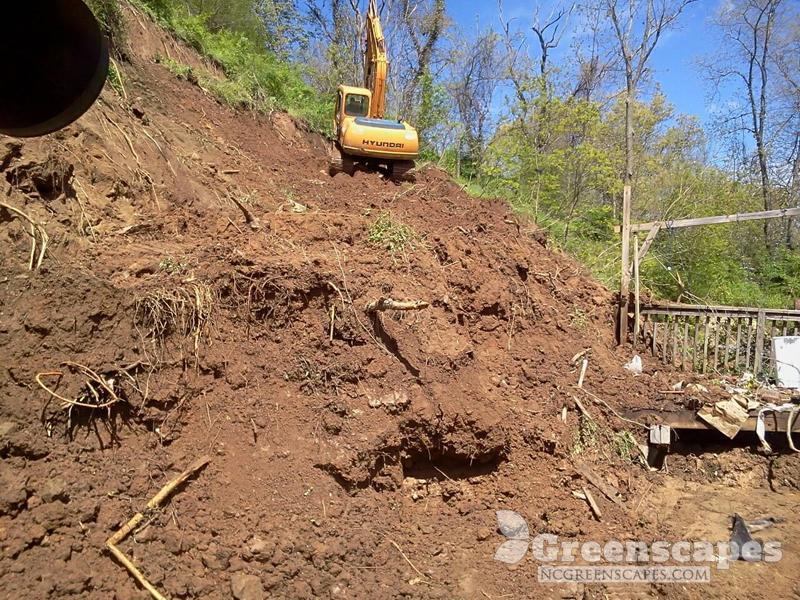 Crawling excavator climbing up a mountain to break up land