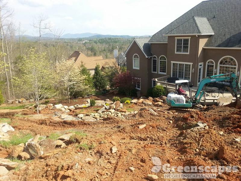 heavy equipment contractor moving dirt around in a luxury homes neighborhood