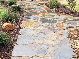 glossy mountain mist flagstone leading to outdoor kitchen in backyard