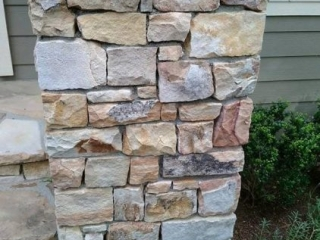 natural stone column leading to entryway for home