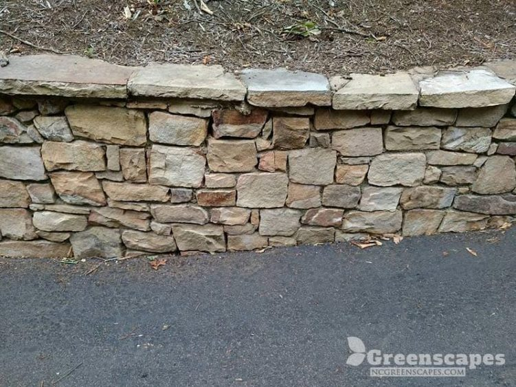 4 foot high natural stone retaining wall