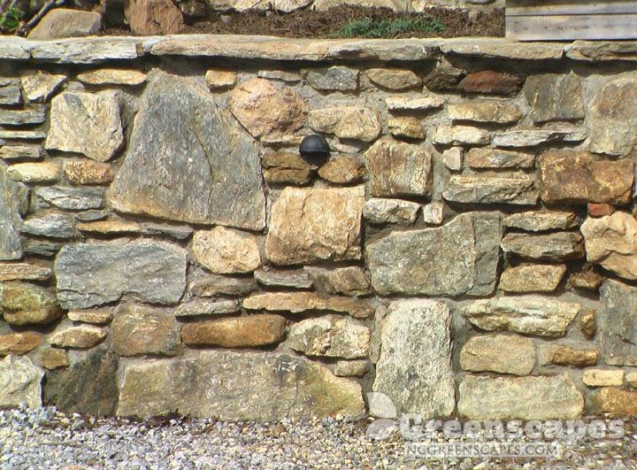 Masonry contractor solved drainage problem with doggett stone retaining walls