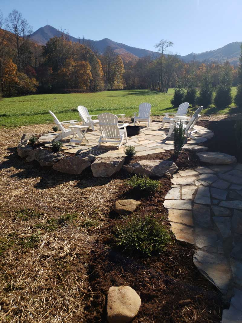 6 white chairs with landscaping and mountain view