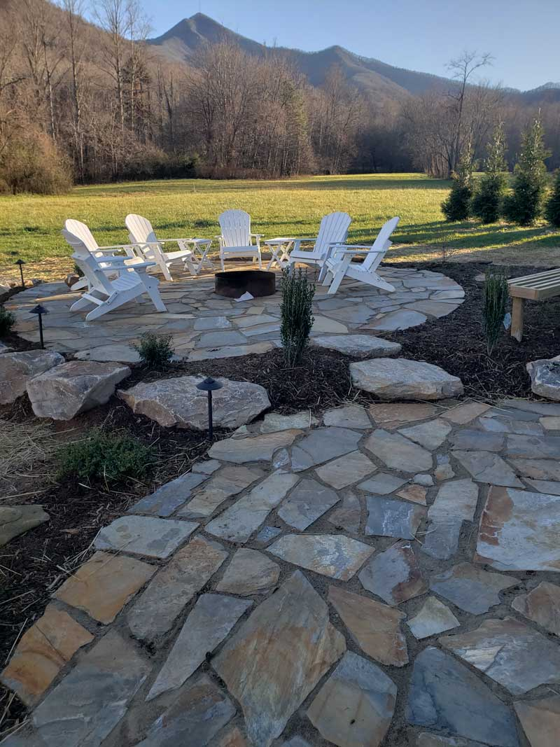 Outdoor firepit with 6 chairs and the mountains to view