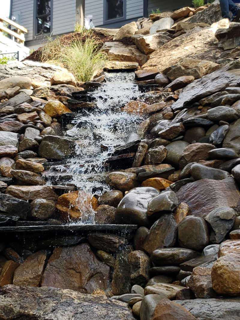 home waterfall made with river rock