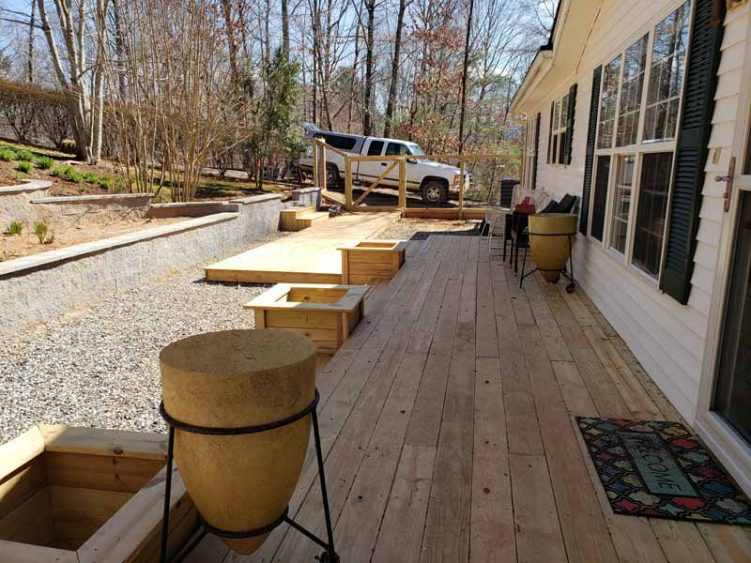 newly completed pressure treated deck with custom planters